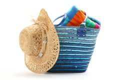Beach bag with straw hat and towel. Isolated on white background Royalty Free Stock Photo
