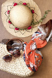 Beach bag with straw hat on wooden background Royalty Free Stock Photography