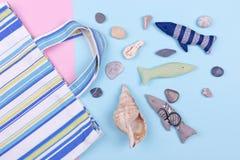 Beach bag and summer trivia. Bag, fabric fish, seashells. Child luggage at sea Stock Photography