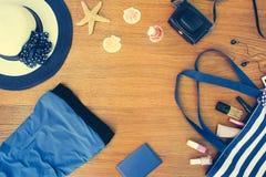Beach bag, sun hat, cosmetics, dress, camera, seashells Stock Photography
