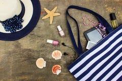 Beach bag, sun hat, cosmetics, mobile phone, tablet, seashells headphones Royalty Free Stock Photography
