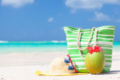 Beach bag, sunglasses and straw hat on tropical Stock Photo