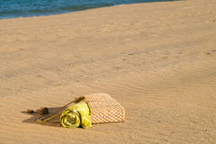 Beach bag on sand Royalty Free Stock Photos