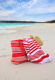 Beach bag towel and hat on the sand Royalty Free Stock Image
