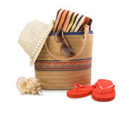 Beach bag and towel with sunbathing accessories isolated on white. Background Royalty Free Stock Photos