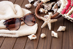 Beach bag with towel, sunglasses   on  wooden background Stock Image
