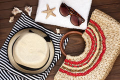 Beach bag with towel, sunglasses  on  wooden background Stock Photo
