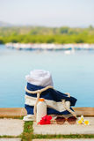 Beach bag, towel, sunscreen and sunglasses Stock Photos