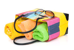 Beach bag with towels and sunglasses Royalty Free Stock Images