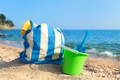 Beach bag and toys at the beach. Vacation at the beach coast with beach bag and toys Stock Photo
