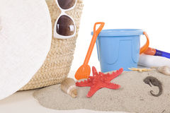 Beach bag with toys and sunglasses Royalty Free Stock Image