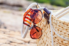 Beach bag and womanly accessories. Photo of beach bag and womanly accessories Royalty Free Stock Photos