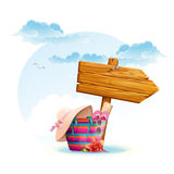 Beach bag with a wooden pointer.  Royalty Free Stock Photography