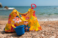 Beach bags. Colorful beach bag with toys in the sand Stock Images
