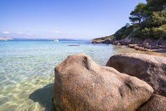 The beach at Baja Sardinia in Sardinia, italy. View of the beautiful beach at Baja Sardinia on Sardinia island, Italy Royalty Free Stock Images