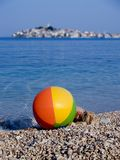 Beach ball. Sea and old town at the background Royalty Free Stock Photo