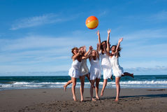 Beach ball. Girls in white dresses playing with a beach ball Stock Photos