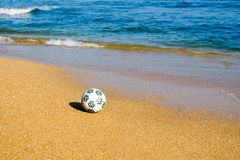 Beach and ball. Ball on seacoast.Blue sea Stock Photos