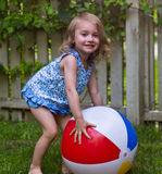 Beach Ball. Young Girl Playing With A Beach Ball in the Backyard Stock Images