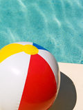 Beach Ball. By swimming pool Royalty Free Stock Photos