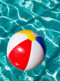 Beach Ball. Colorful beach ball floating in a swimming pool Stock Images