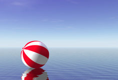 Beach Ball. 3D on a calm sea Stock Images