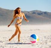 Beach ball babe stock photography