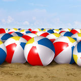Beach Ball Background. As a classic symbol of summer fun at the ocean with a group of inflated plastic spheres of red blue white and yellow stripes as a Stock Photography