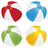 Beach ball basic. A selection of beach balls in basic colors isolated on white Royalty Free Stock Images
