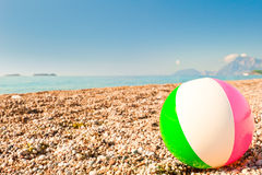 Beach ball on the beach by the sea Royalty Free Stock Images