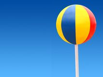 Beach ball on a blue sky Royalty Free Stock Photo