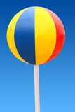 Beach ball on a blue sky. Big color beach ball on a blue sky. Looks like a sweet candy. Ball is isolated and clipping path included royalty free stock photos