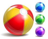 Beach ball. Colorful beach ball  on a white background. Symbol of summer fun at the pool or seaside Royalty Free Stock Photos
