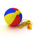 Beach ball with flip flops Royalty Free Stock Photography