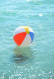 Beach ball floating in the ocean. Royalty Free Stock Photography