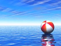 Beach ball floating over lonely sea royalty free stock photos