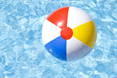 Beach Ball Floating in the Pool Stock Images