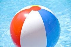 Beach Ball Floating in the Pool Royalty Free Stock Images