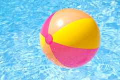 Beach Ball Floating in the Pool Stock Photo