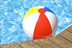 Beach Ball Floating in the Pool Royalty Free Stock Photos