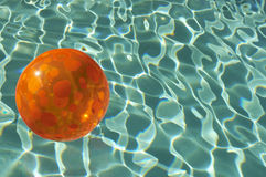 Beach Ball Floating In Pool Stock Photos