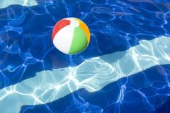 Beach ball floating in swimming pool abstract. Stock Photography