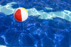 Beach ball floating in swimming pool. Royalty Free Stock Images