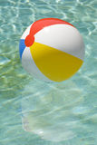 Beach Ball Floating In Swimming Pool Vertical Stock Images