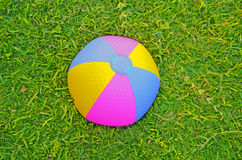 Beach ball in grass Royalty Free Stock Images