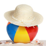 Beach ball and hat on beach sand Royalty Free Stock Photo