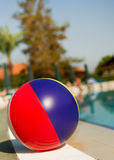 Beach ball near swimming pool Stock Photography