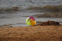 Beach Ball on Ocean Beach. Beach Ball on ocean sand in front of ocean waves taken in Maui Hawaii Royalty Free Stock Photo