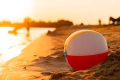 Free Beach Ball On The Seashore At Sunset Royalty Free Stock Image - 123623346