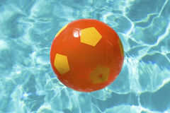 Beach ball over water Stock Photography
